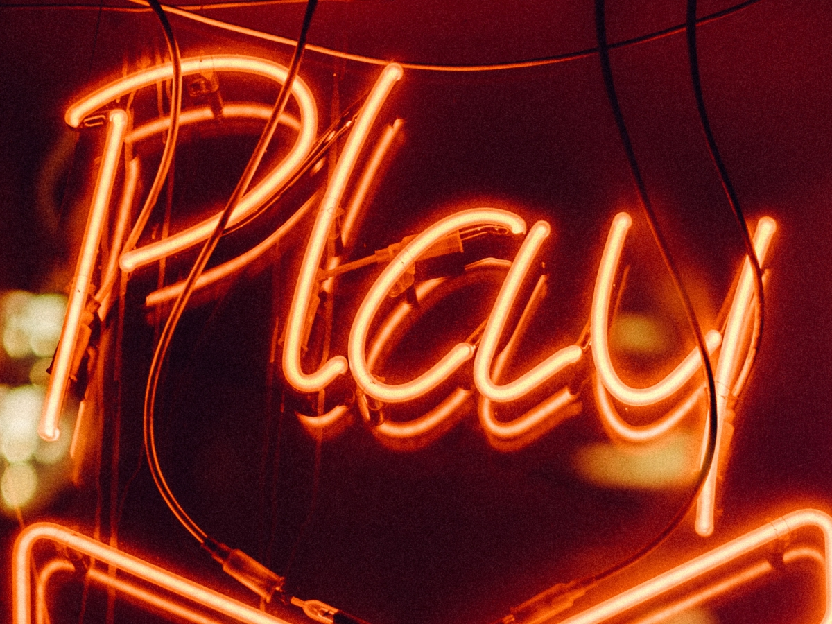 "Neon orange ""Play"" sign"