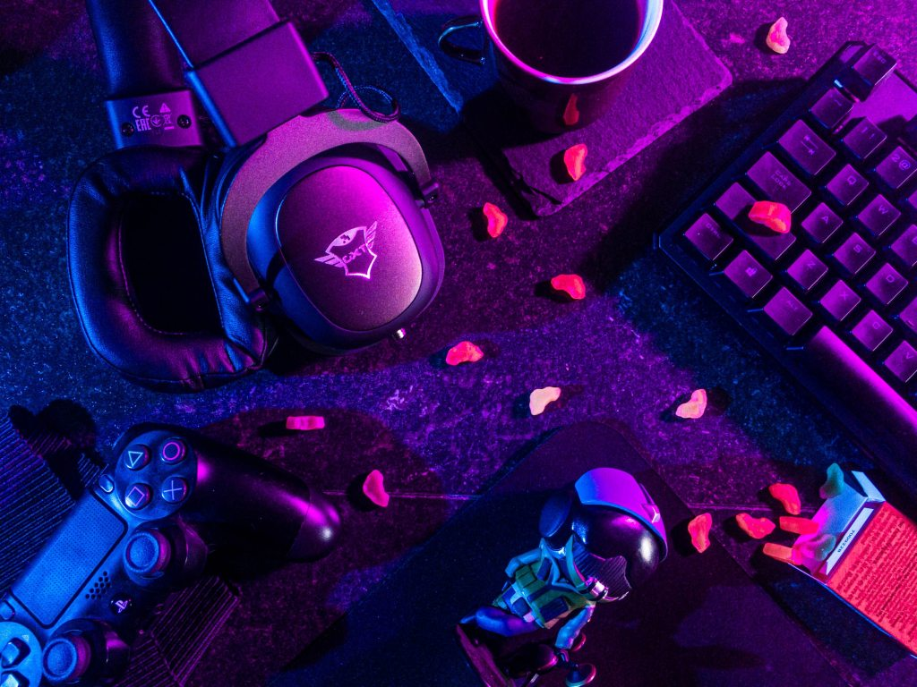 Pink and blue aesthetic computer keyboard and Playstation 4 controller